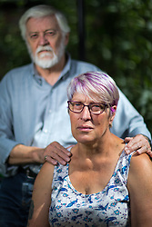 August 13, 2017 - Salford, Greater Manchester, UK - Salford , UK . Husband and wife Tony and Joy Watson (70 and 59 respectively) pictured in their garden in Eccles . Joy has Alzheimer's disease and has had to quit her job as a carer . As a campaigner and educator on the needs of people with dementia , she was praised by former Prime Minister David Cameron , who awarded her a Points of Light Award . But she and her retired husband and full-time carer, Tony, say they now struggle to pay their bills after an assessment by the DWP saw all their financial support withdrawn . For more information see http://www.mirror.co.uk/news/uk-news/woman-dementia-praised-david-cameron-10983661  (Credit Image: © Joel Goodman/London News Pictures via ZUMA Wire)
