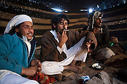 Young Bedouin men relax in their remote home encampment in Wadi Rum, Jordan.