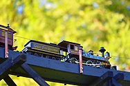 Old Westbury, New York, U.S. June 23, 2021. Long Island Railroad model trains, a large G gauge, travel outdoors during the Old Westbury Gardens opening reception for its Great Pine Railway exhibit, which includes Long Island landmarks and runs until September 6.