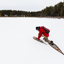 Old school snowshoes on Round Pond, Barrington, New Hampshire.