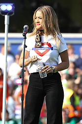 Rita Ora and Emily Asundi sing at halftime at the Game for Grenfell at Loftus Road London<br /><br />2 September 2017.<br /><br />Please byline: Vantagenews.com