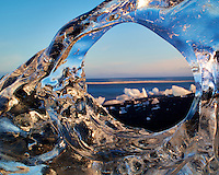 Northern Atlantic Ocean Through Glacial Ice at the Beach near Jökulsárlón in Southeastern Iceland. Image taken with a Nikon D800 and 45 mm f/2.8 PC-E lens and 5 stop Singh-Ray neutral density filter (ISO 50, 45 mm, f/34, 8 sec). Nikonians Iceland Photo Adventure with Mike Hagen and Tim Vollmer