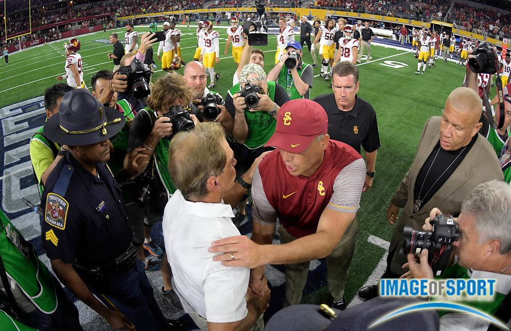 Sep 3, 2016; Arlington, TX, USA; Alabama Crimson Tide head coach Nick Saban (left) shakes hands with USC Trojans head coach Clay Helton (right) after the game at AT&T Stadium.