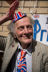 25/04/2015. Royal fan David Jones (79) puts on a union flag hat while waiting outside the Lindo Wing of St Mary's hospital in Padding, where The Duchess is due to give birth. Photo credit: Ben Cawthra