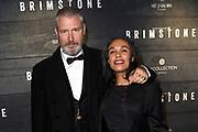 Premiere Brimstone in Pathe Tuschinski, Amsterdam.<br /> <br /> Op de foto:  Eric Corton en partner Diana Sno