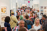 The Affordable Art Fair opens in Hampstead and runs until 15 June. It offers visitors a chance to purchase work from over 100 galleries at prices between £40 and £4,000. Hampstead Heath, London UK 11 June 2014.  Guy Bell, 07771 786236, guy@gbphotos.com