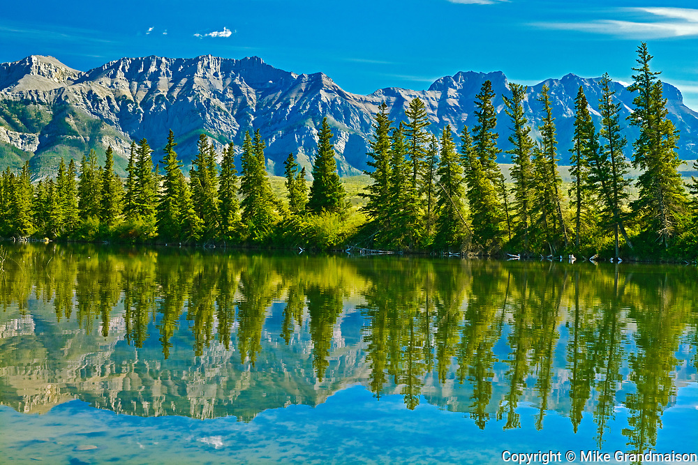 Canadian Rocky Mountains  and trees reflected in Talbot Lake, Jasper National Park, Alberta, Canada