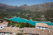 View of the reservoir on the Guadalest river, from San Jose Castle (Castell d'Alcozaiba), with part of the town of El Castell de Guadalest in the foreground.