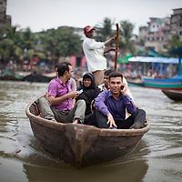 passengers on a small river taxi on the Buriganga river, Bangladesh