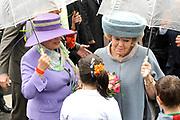 Koninginnedag 2010 . De Koninklijke familie in het zeeuwse Wemeldinge. / Queensday 2010. The Royal Family in Wemeldinge<br /> <br /> op de foto / on the photo : Karla Peijs en Beatrix