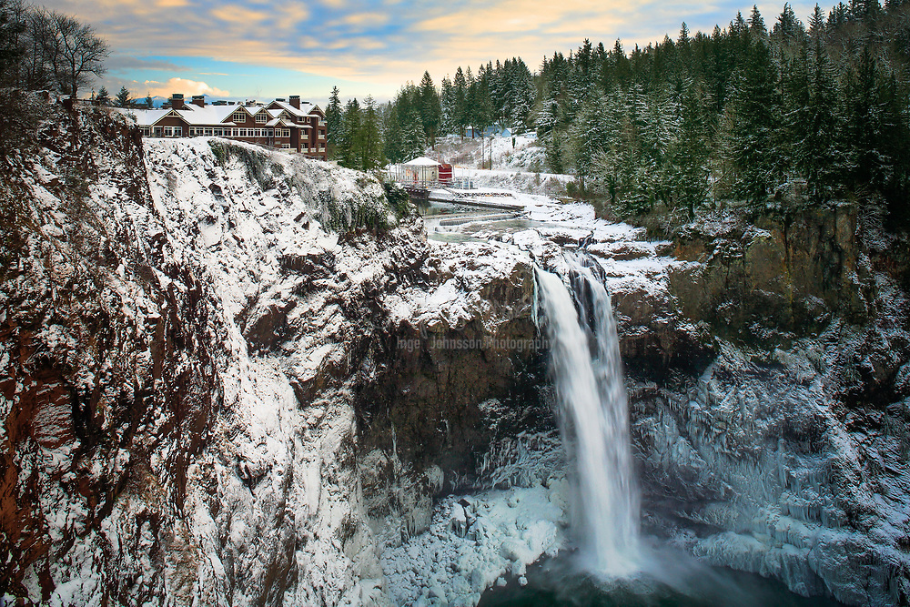 Winter below Snoqualmie Falls in Washington state, USA<br /> .....<br /> Snoqualmie Falls is a 268 ft (82 m) waterfall on the Snoqualmie River between Snoqualmie and Fall City, Washington, USA. It is one of Washington's most popular scenic attractions, but is perhaps best known internationally for its appearance in the cult television series Twin Peaks. More than 1.5 million visitors come to the Falls every year, where there is a two-acre (0.8 ha) park, an observation deck, and a gift shop.<br /> <br /> Most of the river is diverted into the power plants, but at times the river is high enough to flow across the entire precipice, which creates an almost blinding spray. High water occurs following a period of heavy rains or snow followed by warm rainy weather. This can occur during the rainy season which lasts from November through March. During high water, the falls take on a curtain form.<br /> Snoqualmie Falls is a 268 ft (82 m) waterfall on the Snoqualmie River between Snoqualmie and Fall City, Washington, USA. It is one of Washington's most popular scenic attractions, but is perhaps best known internationally for its appearance in the cult television series Twin Peaks. More than 1.5 million visitors come to the Falls every year, where there is a two-acre (0.8 ha) park, an observation deck, and a gift shop.<br /> <br /> Most of the river is diverted into the power plants, but at times the river is high enough to flow across the entire precipice, which creates an almost blinding spray. High water occurs following a period of heavy rains or snow followed by warm rainy weather. This can occur during the rainy season which lasts from November through March. During high water, the falls take on a curtain form.