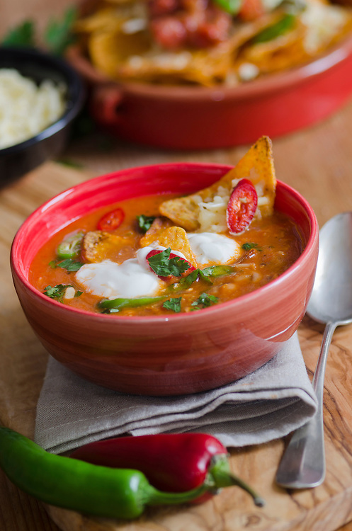 Spicy Mexican Chicken Soup With Tortilla Chips And Chilli Peppers