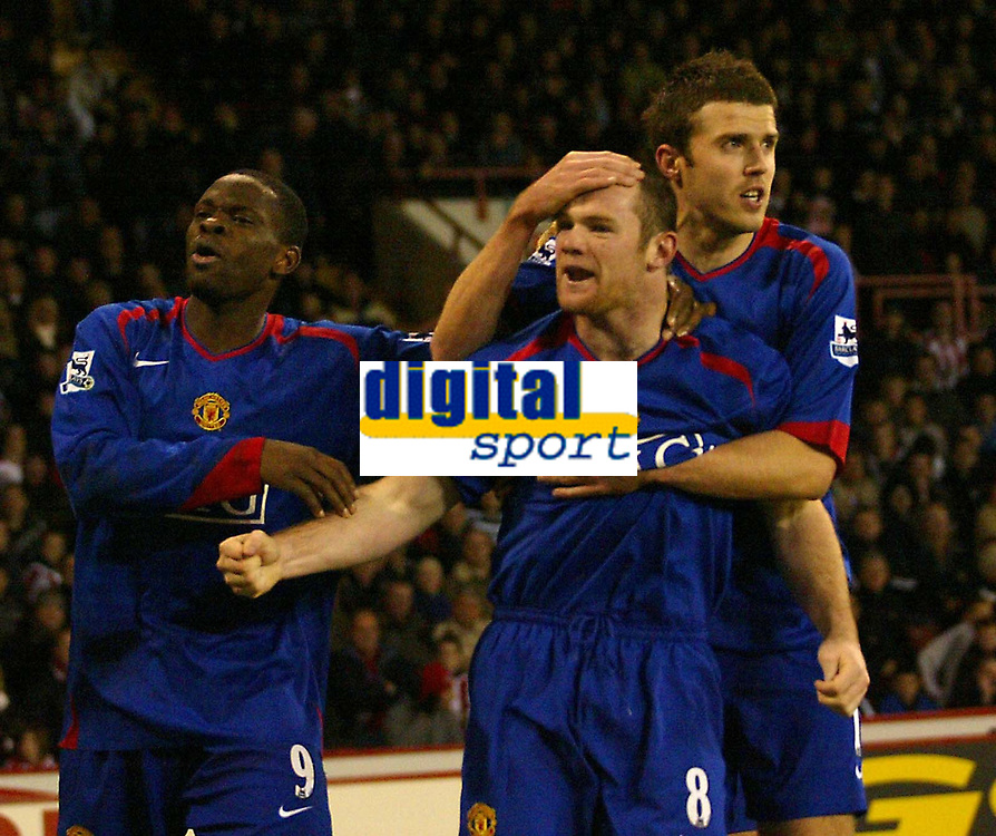 Photo: Aidan Ellis.<br /> Sheffield United v Manchester United. The Barclays Premiership. 18/11/2006.<br /> Manchester's Wayne Rooney (center) celebrates his second goal with Louis Saha and Michael Carrick