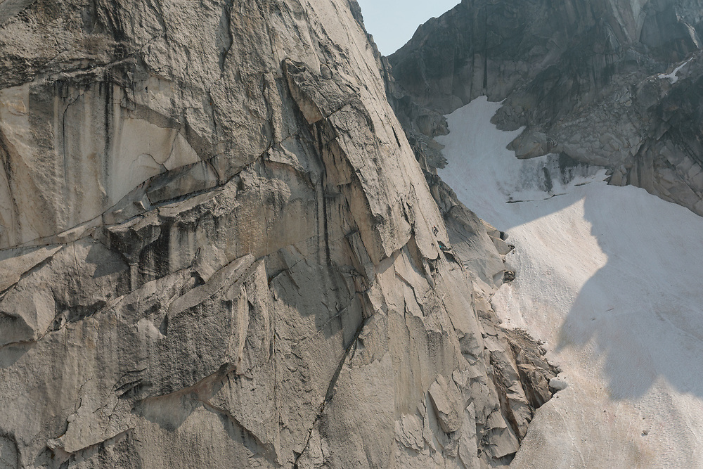 Alex climbing the crux pitch of Fingerberry Jam, 5.12a in the Bugaboos