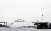 Big boat and small kayak by bridge in Haugesund - stor båt og liten kajakk ved bru i innseilinga til Haugesund