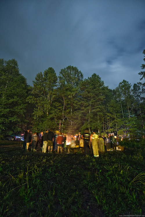 A crowd of hikers form a writhing circle around the anual bon fire at the Trail Days celebration in Damascus Virginia.