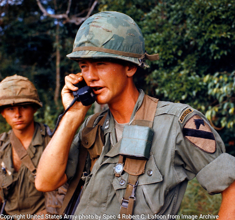The AN/ARC-122 radio is used in UH-1D helicopters by the 1st Cavalry Division, Airmobile, at division, brigade and battalion levels to coordinate missions with ground forces. Capt. William E. Taylor, company commander, communicates with a battalion commander who is in his airborne command post close by.