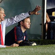 Arsenal's coach Arsene Wenger (3ndL) during the UEFA Champions League Play-Offs First leg soccer match Fenerbahce between Arsenal at Sukru Saracaoglu stadium in Istanbul Turkey on Wednesday 21 August 2013. Photo by Aykut AKICI/TURKPIX