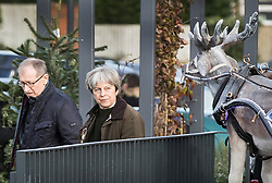 © Licensed to London News Pictures. 09/12/2017. Maidenhead, UK.  Prime Minister Theresa May and her husband Philip pass a replica reindeer as she shopps in her constituency. Photo credit: Peter Macdiarmid/LNP