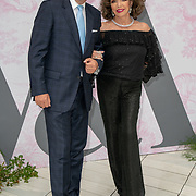 Joan Collins and Percy Gibson arrives at V&A - summer party, on 19 June 2019, London, UK