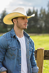 profile of a good looking cowboy outdoors