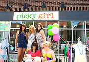 Models wearing designer clothes in front of clothing boutique. Grand Old Day Festival. St Paul Minnesota MN USA