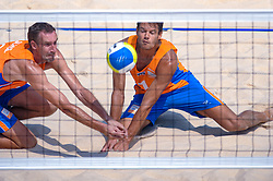Reinder Nummerdor and Richard Schuil (L) of Netherlands, in action on the center court of the Chaoyang Park Beach Stadium on August 18, 2008 in Beijing