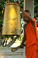 Novice Banging the Temple Bell at Wat Siphoutthabat - Buddhism is the primary religion of Laos. The Buddhism practiced in Laos is of the Theravada tradition. Lao Buddhism is a unique version of Theravada Buddhism and is at the basis of Lao culture. Buddhism in Laos is often closely tied to animist beliefs and belief in ancestral spirits, particularly in rural areas