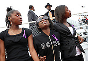 """ORG XMIT: *S0425656883* (02/07/09) -- Left to right, Lancaster High School track team members Atrice Lockett, Breon Anthony and Debrecia Smith grieve after walking behind the coffin of teammate Sharla Lashawn Butler as it made a """"victory lap"""" around the track at Beverly D. Humphrey Stadium in Lancaster before processing to the funeral service Saturday February 9, 2009.  Butler died of encephalitis this week.  (Courtney Perry/The Dallas Morning News.) <br /> 02082009xMETRO"""