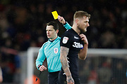 Referee Darren England shows a yellow card to Leeds United defender Liam Cooper  during the EFL Sky Bet Championship match between Middlesbrough and Leeds United at the Riverside Stadium, Middlesbrough, England on 2 March 2018. Picture by Paul Thompson.
