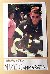 14 September 2001. New York, New York - USA.<br /> Post 9/11 World Trade Center attack.<br /> Mike Cammarata, firefighter. Missing presumed dead. Hero firefighter, colleague of Mike Kehoe of Engine 28, Ladder 11 pictured in a memorial erected at their firehouse on East 2nd Street in the East village early in the morning of Sept 14th. <br /> Mike Kehoe's image had been published the day before on front pages around the world. It is the iconic image of him ascending the stairs of the World Trade Center as he helped to evacuate people from the terrorist attacks of 9/11. It was assumed Mike had perished when the buildings collapsed. However Mike had miraculously managed to escape the buildings moments before they collapsed. 6 members of his crew were not so fortunate. Mike became a symbol of heroism to many following the vicious Al Queda attacks which claimed over 2,000 victims at the WTC site. This images was published exclusively on the Front Page of the Daily Mirror on 15th Sept, 2001.<br /> Photo exclusive©; Charlie Varley/varleypix.com