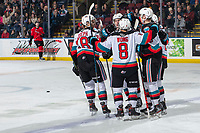 KELOWNA, BC - DECEMBER 30: Jadon Joseph #18, Mark Liwiski #9, Trevor Wong #8 and Ethan Ernst #19 skate to Kaedan Korczak #6 of the Kelowna Rockets to celebrate a first period goal against the Prince George Cougars at Prospera Place on December 30, 2019 in Kelowna, Canada. (Photo by Marissa Baecker/Shoot the Breeze)