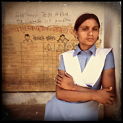 """iPhone portrait of Mamta Bairwa, 17, in a village of Rajasthan, India, April 3, 2013. """"It becomes very sad to have children at a young age and not be able to take care of them. If I would get married at a young age then I would not be able to study. I would not be able to write. How would I handle the education of the children? With an education, one can achieve. With marriage at a young age we are unable to study, one gets no education. One remains illiterate. If marriage happens later, then one can look for an educated partner. And then marriage happens at the right time,"""" said Bairwa.<br /> <br /> Under Indian law, children younger than 18 cannot marry. Yet in a number of India's states, at least half of all girls are married before they turn 18, according to statistics gathered in 2012 by the United Nations Population Fund (UNFPA). However, young girls in the Indian state of Rajasthan—and even a few boys—are getting some help in combatting child marriage. In villages throughout Tonk, Jaipur and Banswara districts, the Center for Unfolding Learning Potential, or CULP, uses its Pehchan Project to reach out to girls, generally between the ages of 9 and 14, who either left school early or never went at all. The education and confidence-building CULP offers have empowered young people to refuse forced marriages in favor of continuing their studies, and the nongovernmental organization has provided them with resources and advocates in their fight."""