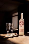 Glasses by bottle of Fundo Los Nichos brandy