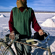 Pánfilo  Marques  that lives in population of Colchani internal every day through several km in the salar for fourteen years to be going to be employed at the extracion of of salt.  Salar de Uyuni ( Uyuni salt flat ) . Department  of Potosí  ( Los Lipez).  South West  Bolivia. <br /> Adult Altiplano America Andes Arid  Aridity Barren  Bicycle Bolivia Color Colour Cone  Day Daytime  Department  Desert Desolate Desolation Dry  Exterior Extraction  Geography Hard Heat Highlands  Horizon Human  Latin America Lake  Los Lipez Male Man Men Miner Mining Nature  Resource  Natural  One Outdoors Outside  Pan People  Person Pyramide Potosí  Production  Region Resource Rural Salar de Uyuni  Salt Flat  Salt Pan  Salt lake  Scenic Seasoning  Single Shape South America  Southwest  Sud Sunglasses  Surface Travel Vertical West White Work  Worker Working