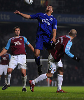 Photo: Tony Oudot/Sportsbeat Images.<br /> West Ham United v Everton. Carling Cup. 12/12/2007.<br /> Tim Cahill of Everton outjumps Freddie Ljungberg of West Ham