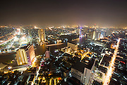 Lebua at State Tower Hotel. Breathtaking night view over Chao Phraya River and the skyscrapers at its banks.