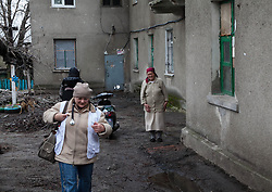 Nina Prokopenko smiles as she says goodbye to MSF doctor, Svetlana Niekurasa and the MSF home visit team after they visited her and her husband, Ivan, in their apartment in Debaltsevo.