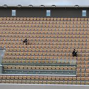 PARIS, FRANCE October 09.  Professional sports photographers working in the empty upper tier during the Rafael Nadal of Spain match against Diego Schwartzman of Argentina in the Semi Finals of the singles competition on Court Philippe-Chatrier during the French Open Tennis Tournament at Roland Garros on October 9th 2020 in Paris, France. (Photo by Tim Clayton/Corbis via Getty Images)