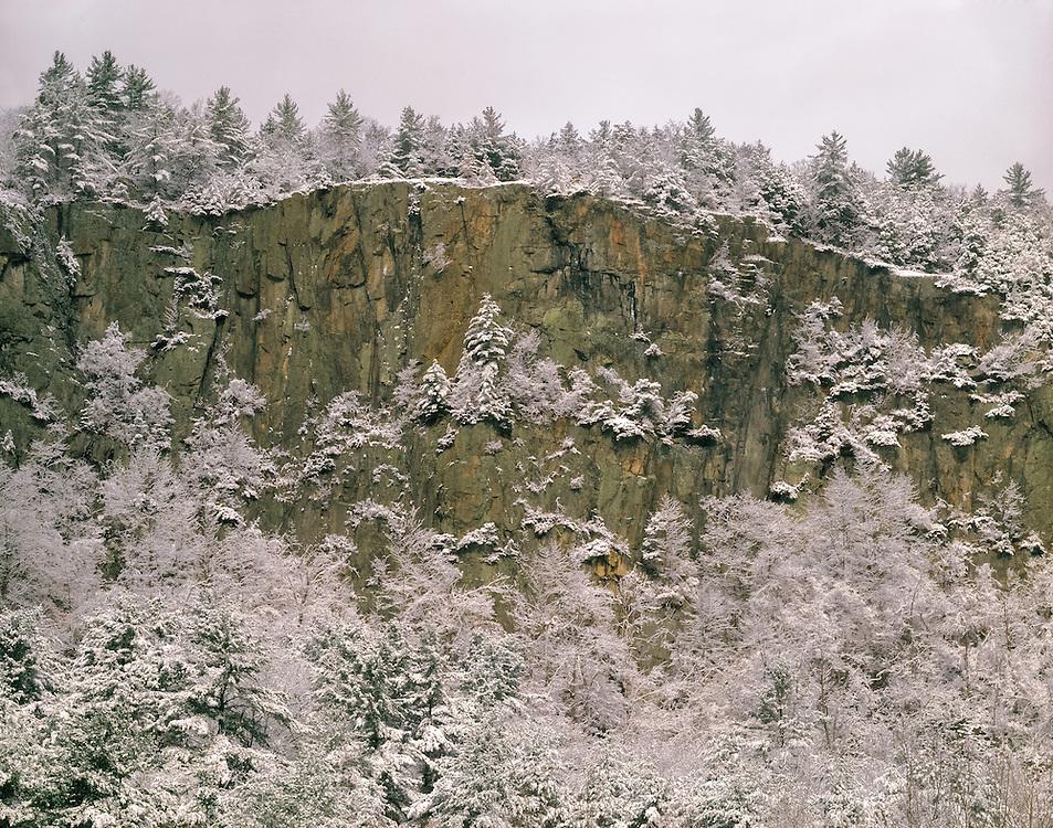 Fresh snow covers trees along edge of sheer rock cliffs, Fairlee, VT