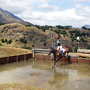 Tania Bellamy riding Laurant in action at the water jump during the Cross Country event at the Wakatipu One Day Horse Trials at the Pony Club grounds,  Queenstown, Otago, New Zealand. 15th January 2012. Photo Tim Clayton