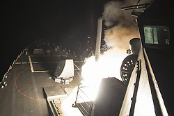 April 7, 2017 - Mediterranean Sea - In this photo released by the United States Navy, the USS Ross (DDG 71) fires a tomahawk land attack missile. USS Ross, an Arleigh Burke-class guided-missile destroyer, forward-deployed to Rota, Spain, is conducting naval operations in the U.S. 6th Fleet area of operations in support of U.S. national security interests in Europe and Africa in the Mediterranean Sea. (Credit Image: © Robert S. Price/CNP via ZUMA Wire)