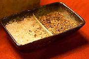 Salt and pepper beaker on a red table cloth. at the gastronomic restaurant L'Enfance de Lard Bergerac Dordogne France