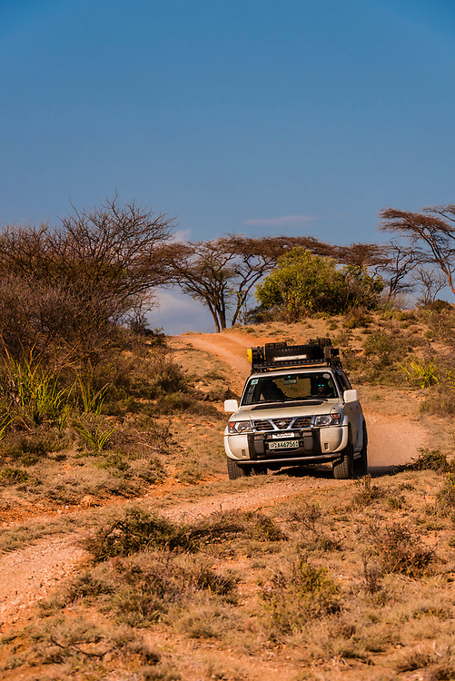 Four wheel drive vehicle navigating one of the many dirt roads in the Omo Valley, Ethiopia.