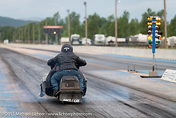 A snowmobile races at the Baker Drivetrain sponsored drags at the Sturgis Dragway during the 75th Annual Sturgis Black Hills Motorcycle Rally.  SD, USA.  August 4, 2015.  Photography ©2015 Michael Lichter.