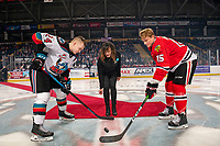 KELOWNA, BC - FEBRUARY 8: CMHA representative Jessica Samuels stands at center ice for the ceremonial face-off between Kyle Topping #24 of the Kelowna Rockets and Johnny Ludvig #15 of the Portland Winterhawks at Prospera Place on February 8, 2020 in Kelowna, Canada. (Photo by Marissa Baecker/Shoot the Breeze)