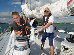 Simon Le Bon, with 14 year old Marcus Ellsom, on a 72 foot Challenger yacht in the Solent off Portsmouth where he announced his partnership with the Tall Ships Youth Trust .