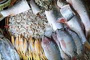 Fresh fish and shrimps for sale at an early morning street market in Yangon on 16th January 2016, Myanmar.  A large variety of local products are available for sale in fresh markets all over Yangon, all being sold on small individual stalls