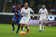 Andre Ayew of Swansea city breaks away from Hiram Boateng of Crystal Palace. Barclays Premier league match, Swansea city v Crystal Palace at the Liberty Stadium in Swansea, South Wales on Saturday 6th February 2016.<br /> pic by Andrew Orchard, Andrew Orchard sports photography.