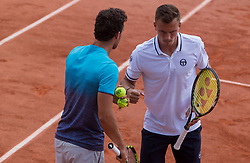 May 30, 2018 - Paris, Ile-de-France, France - Márton Fucsovics of Hungary and Marco Cecchinato of Italy serves against Lukasz Kubot of Poland and Marcelo Melo of Brazil during the second round at Roland Garros Grand Slam Tournament - Day 4 on May 30, 2018 in Paris, France. (Credit Image: © Robert Szaniszlo/NurPhoto via ZUMA Press)